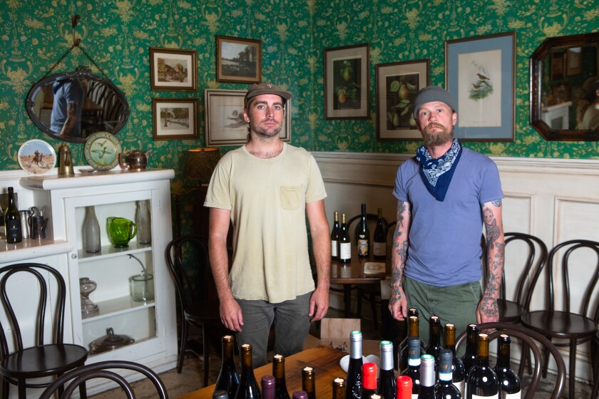 Hatchet Hall co-owners Jonathan Strader, left, and chef Brian Dunsmoor relaunched their Culver City restaurant as Hatchet Market.