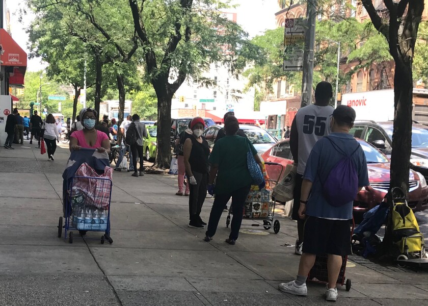The line for food at the Community Kitchen and Pantry in Harlem stretched down the block of West 116th Street.