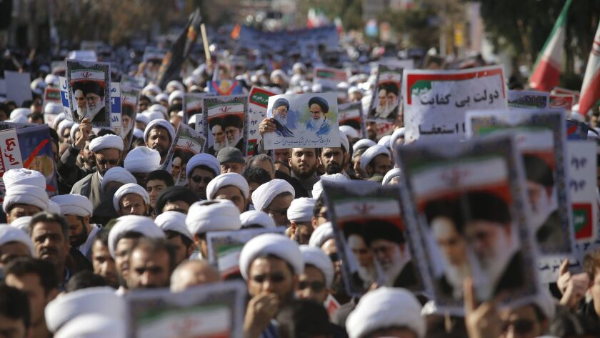 Iranian clerics in the city of Qom take part in a Jan. 3 state-organized rally against anti-government protests.
