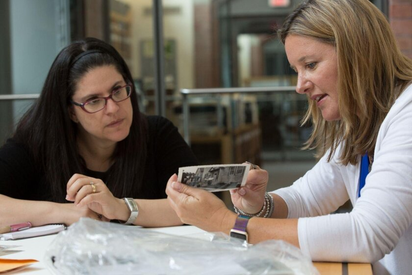 Cardiff resident Corey Samuels (right) meets June 27 with a curator at the U.S. Holocaust Memorial Museum in Washington, D.C.