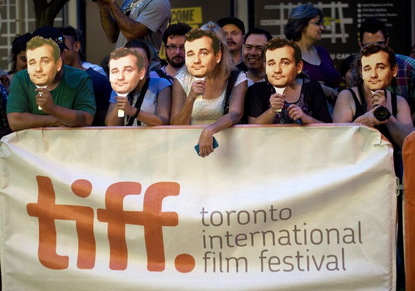 "Bill Murray fans wait outside the screening of the new movie ""St. Vincent"" during the 2014 Toronto International Film Festival in Toronto on Friday, Sept. 5, 2014. (AP Photo/The Canadian Press, Nathan Denette)"