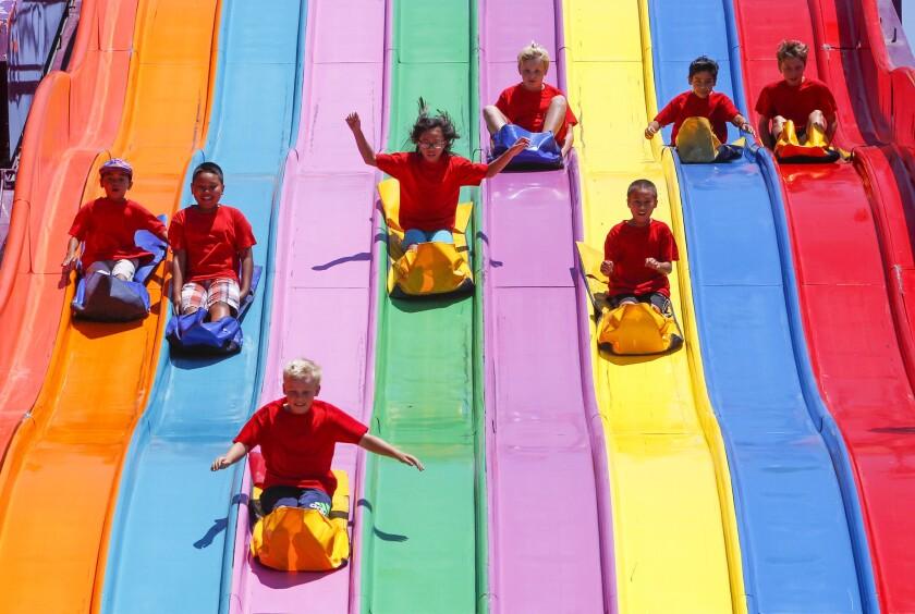 Children sliding down slides