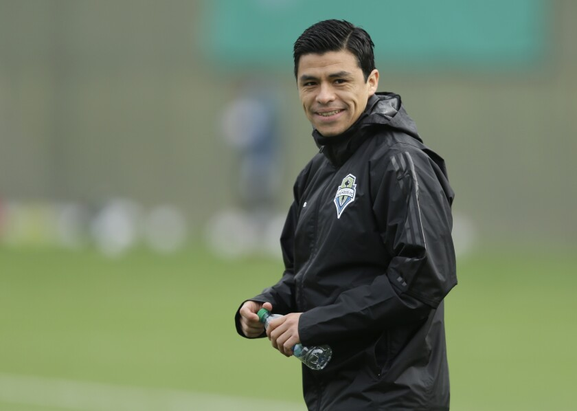 FILE - Seattle Sounders assistant coach and former player Gonzalo Pineda watches drills during a training session in Tukwila, Wash., in this Tuesday, Jan. 24, 2017, file photo. Atlanta United hired former Seattle assistant coach Gonzalo Pineda as the team's head coach on Thursday, Aug. 13, 2021. Pineda, whose contract runs through 2024, replaces Gabriel Heinze, who was fired last month.(AP Photo/Ted S. Warren, File)