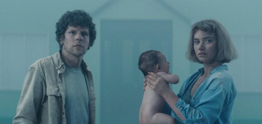 "Jesse Eisenberg and Imogen Poots in the movie ""Vivarium."""