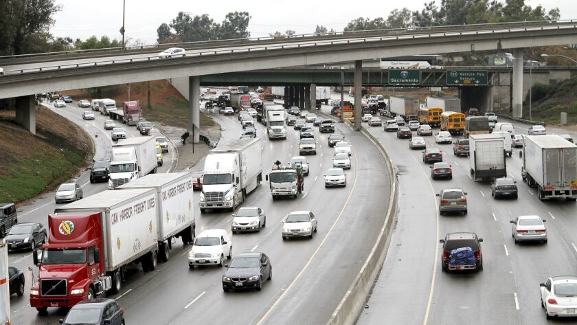 Traffic moves slowly on a rainy morning on the 5 freeway out of and into Burbank at the 134 freeway