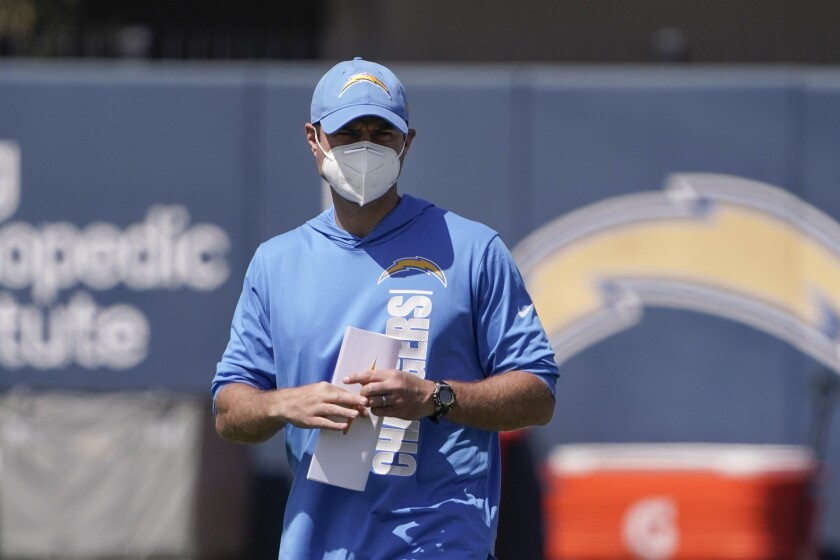 Chargers head coach Brandon Staley watches as his players warm up during minicamp in Costa Mesa.