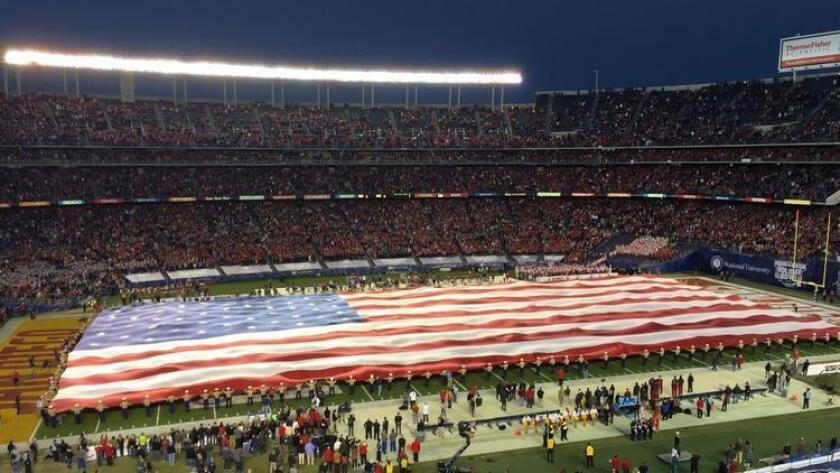 One of the traditions at the San Diego County Credit Union Holiday Bowl is unfurling the Big Flag during the national anthem.