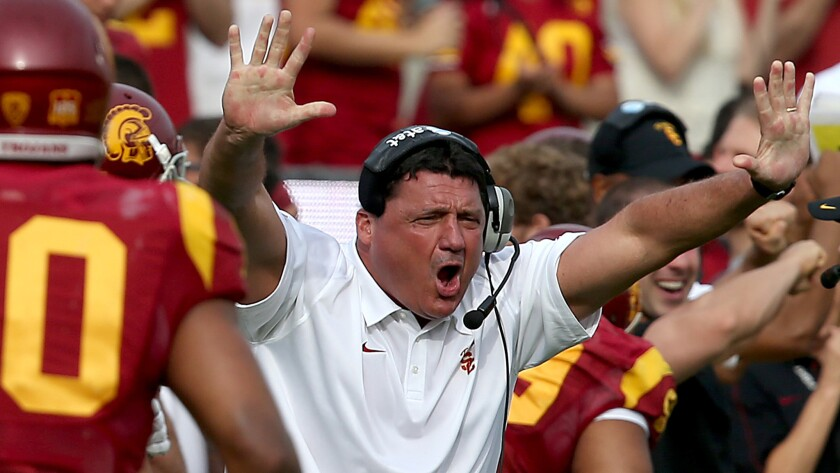 Ed Orgeron directs his players during a game against Utah on Oct. 26, 2013.