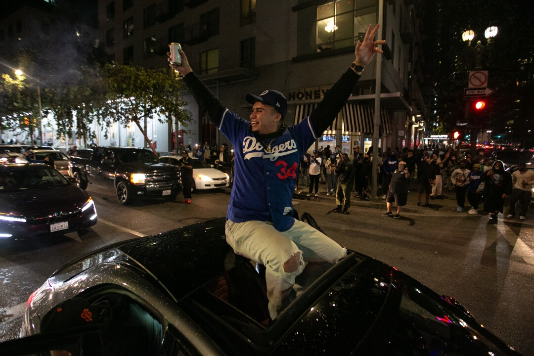 Fans celebrate the Dodgers' World Series victory over the Tampa Bay Rays.