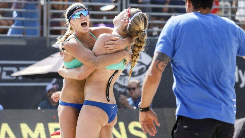 HERMOSA BEACH,CA --SUNDAY, JULY 29, 2018--Sara Hughes, left hugs partner Summer Ross after their def