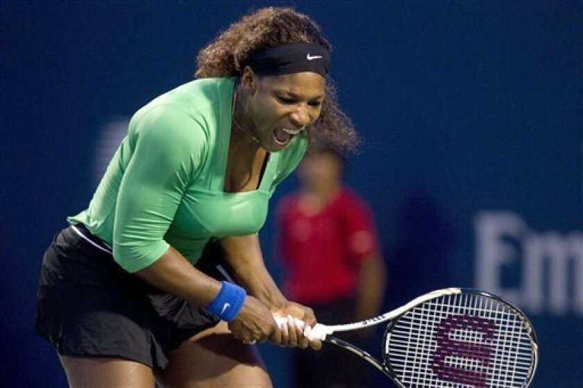 Serena Williams, of the United States, reacts during her victory over Lucie Safarova, of the Czech Republic, during the Rogers Cup tennis tournament in Toronto on Friday, Aug. 12, 2011. (AP Photo/The Canadian Press, Chris Young)