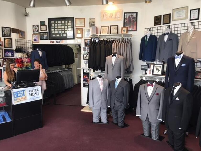 The interior of A Better Deal Designer Tuxedos & Suits with an employee at right and Janet Klein at left. Located at 369 Bird Rock Ave., off La Jolla Blvd., the store sells and rents tuxedos and suits, new or gently worn. (858) 551-6044. abetterdealtuxedo.com