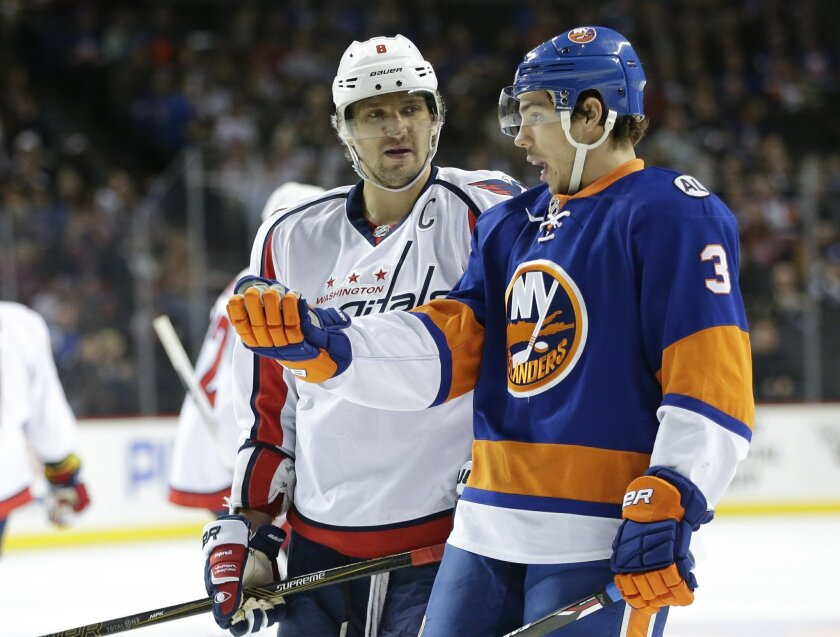 New York Islanders' Travis Hamonic (3) talks to Washington Capitals' Alex Ovechkin (8) during the first period of an NHL hockey game Thursday, Feb. 18, 2016, in New York. (AP Photo/Frank Franklin II)