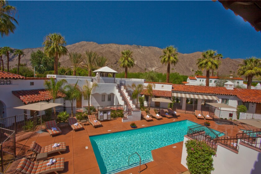 The pool area at Triada Palm Springs set against the backdrop of the San Jacinto Mountains. The historic hotel is now part of Marriott's Autograph Collection.