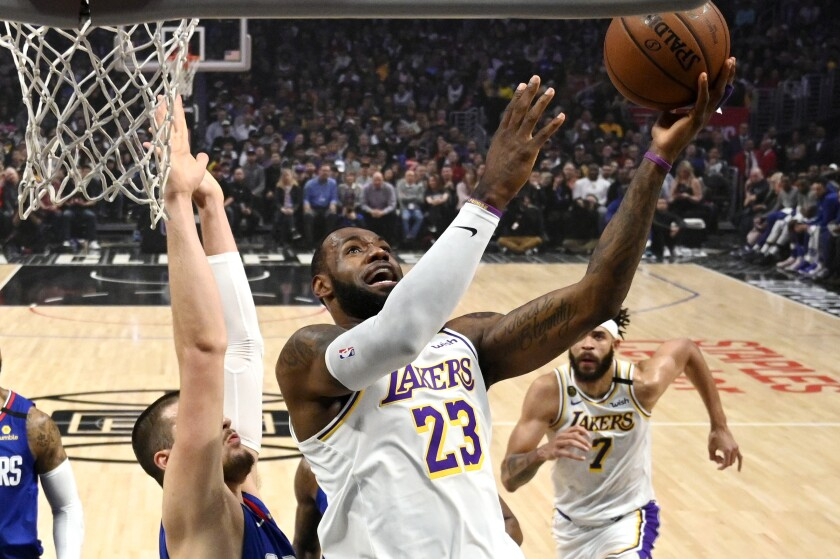 Los Angeles Lakers forward LeBron James (23) shoots as Clippers center Ivica Zubac defends on March 8.