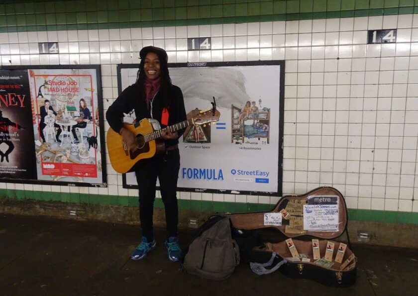 Lola Johnson singing in the 14th Street subway station.