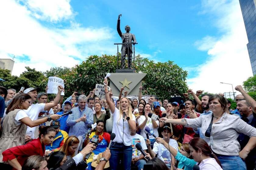 Lilian Tintori, wife of Venezuelan jailed opposition leader Leopoldo Lopez, speaks during a demonstration in Caracas on August 31, 2016.