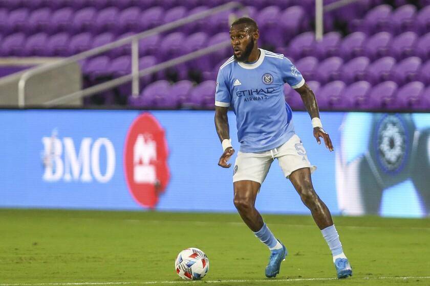 New York City FC defender Sebastien Ibeagha (5) dribbles the ball.