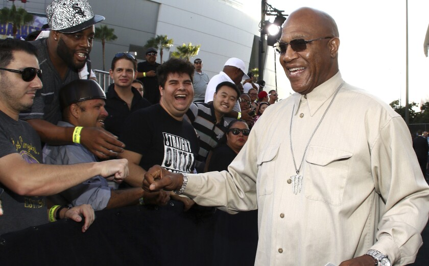Tommy 'Tiny' Lister fist-bumps a fan as people line the red carpet