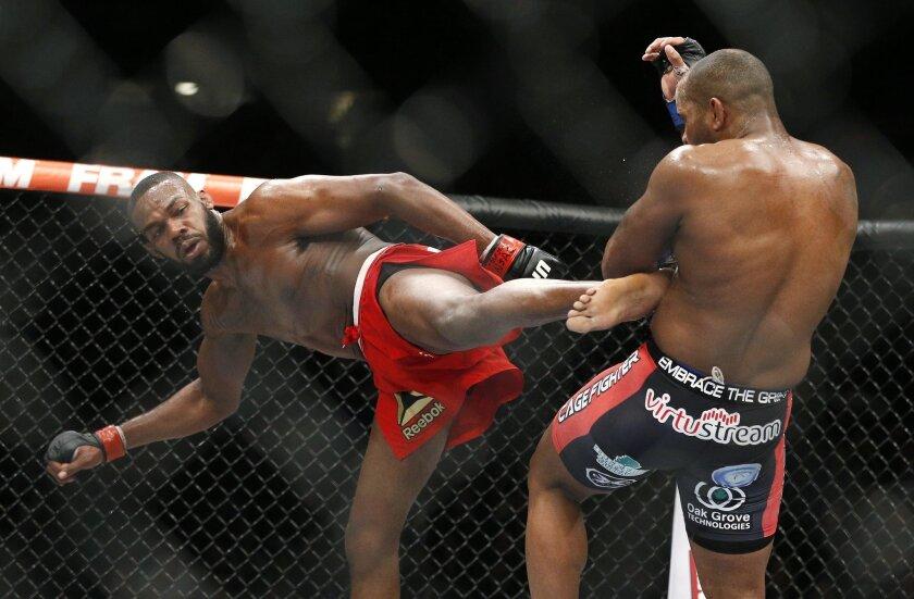 Jon Jones kicks Daniel Cormier during their light heavyweight title mixed martial arts bout at UFC 182 on Jan. 3, 2015.