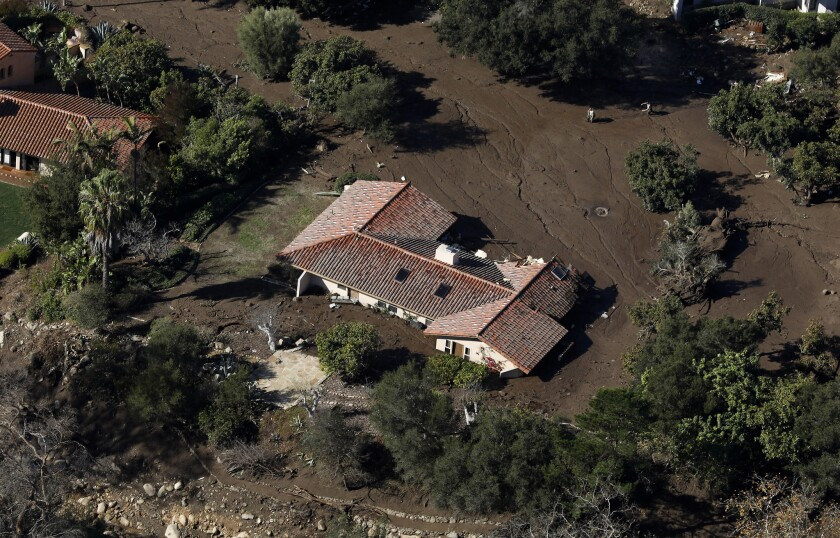A home off Romero Canyon Road in Montecito is inundated with mud.