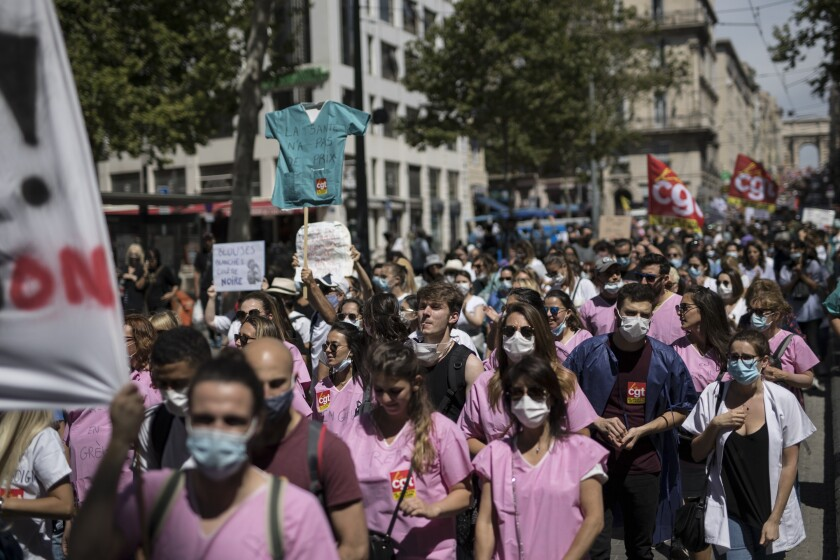 Medical workers march during a demonstration in Marseille, southern France, Tuesday, June 16, 2020. French hospital workers and others are protesting in cities around the country to demand better pay and more investment in France's public hospital system, which is considered among the world's best but struggled to handle a flux of virus patients after years of cost cuts. France has seen nearly 30,000 virus deaths. (AP Photo/Daniel Cole)