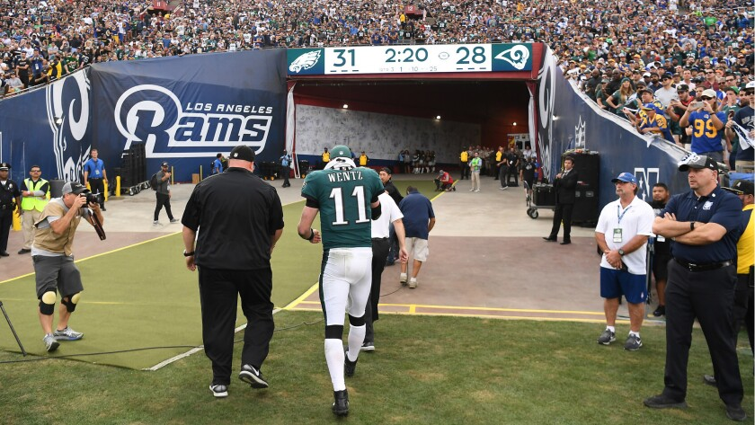 Eagles quarterback Carson Wentz walks off the field after suffering a torn ACL in his left knee against the Rams during the third quarter Sunday.
