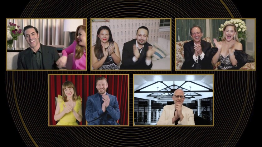 """In this video grab issued Sunday, Feb. 28, 2021, by NBC, nominees in the category best actor in a motion picture, musical or comedy, react as Sacha Baron Cohen, top left, is announced as the winner for """"Borat Subsequent Moviefilm"""" at the Golden Globe Awards. (NBC via AP)"""