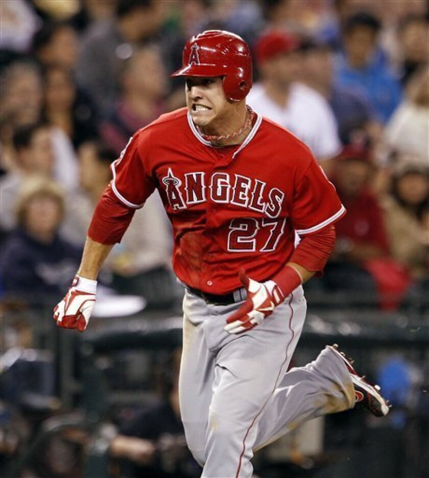 Los Angeles Angels' Mike Trout comes around to score against the Seattle Mariners in the fourth inning of a baseball game Friday, Aug. 31, 2012, in Seattle. (AP Photo/Elaine Thompson)