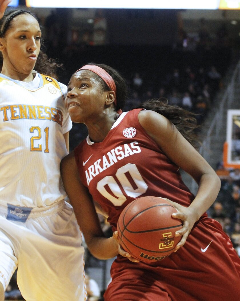 Arkansas's Jessica Jackson (00) shoots a layup against Tennessee's Mercedes Russell (21) in the second half of an NCAA college basketball game, Thursday, Jan. 30, 2014, in Knoxville, Tenn. Tennessee won 70-60. (AP Photo/Lisa Norman-Hudson)