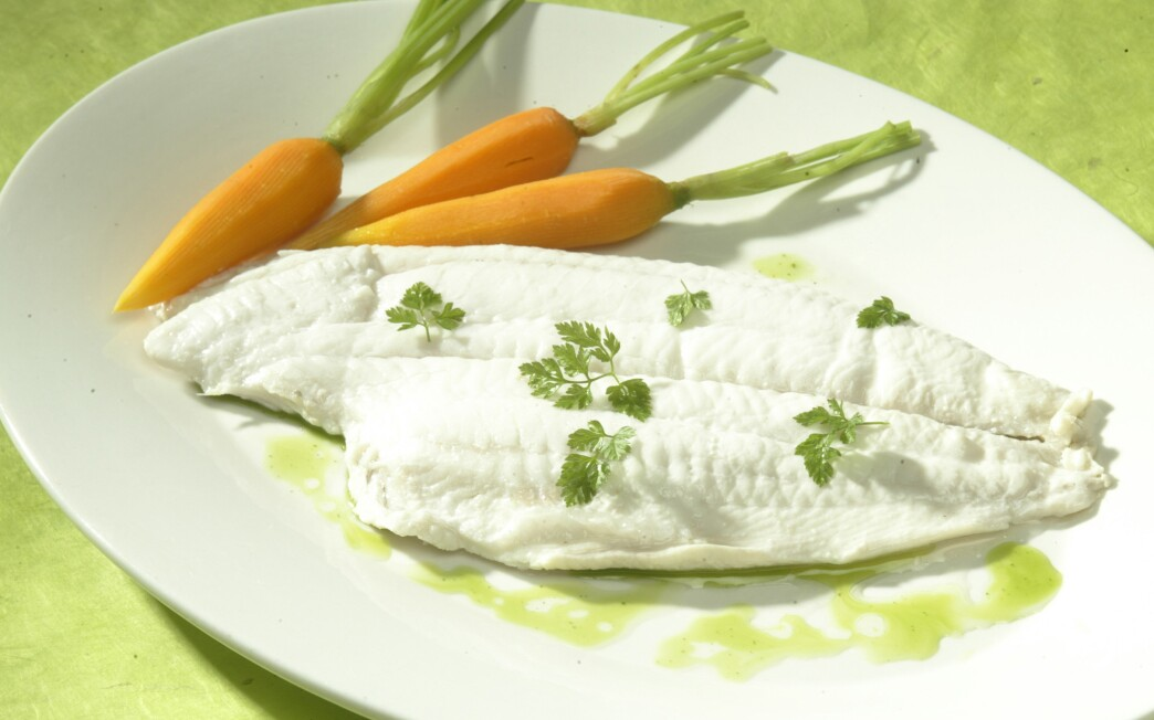 Poached sole with basil-garlic oil and Champagne vinaigrette