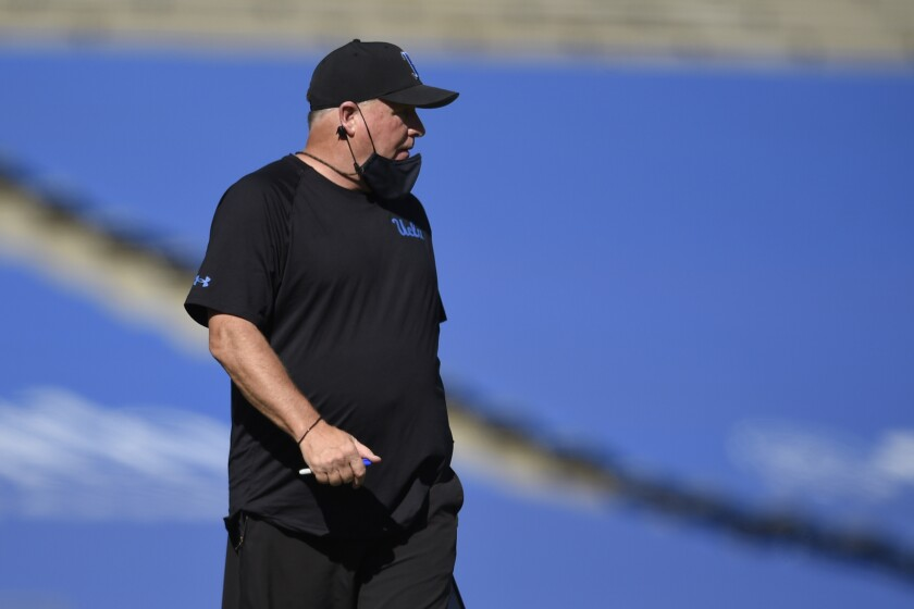 UCLA coach Chip Kelly walks along the sidelines during a game against California on Nov. 15.