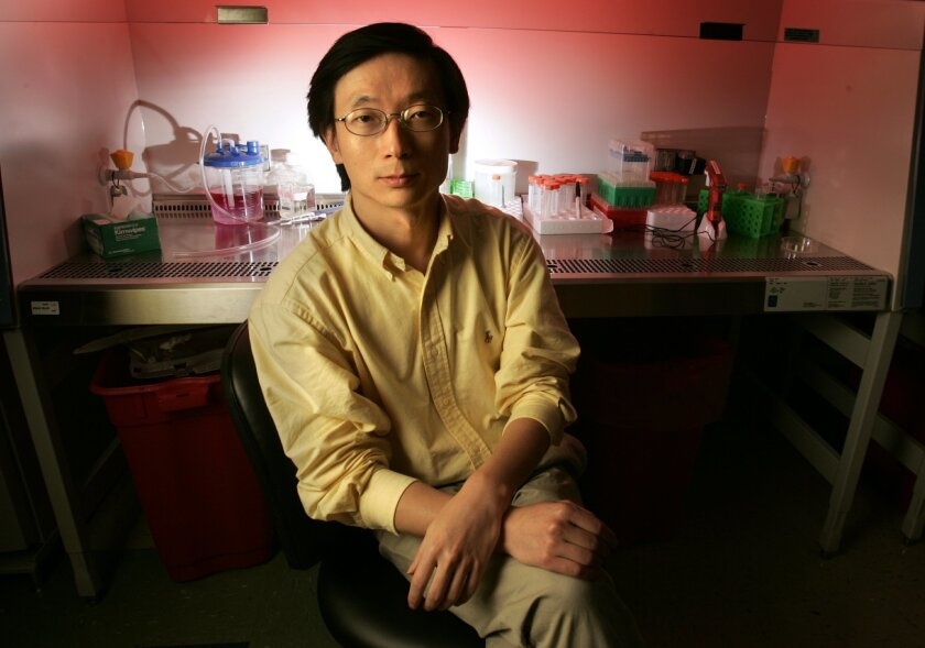 Chemical biologist Sheng Ding at his lab at The Scripps Research Institute in La Jolla. U-T file photo