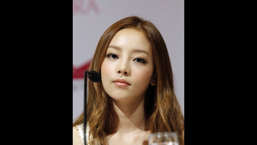 Goo Hara attends a news conference in Singapore in 2012.
