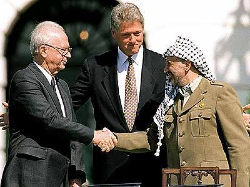 Yitzhak Rabin, President Clinton and Yasser Arafat at the White House in 1993.