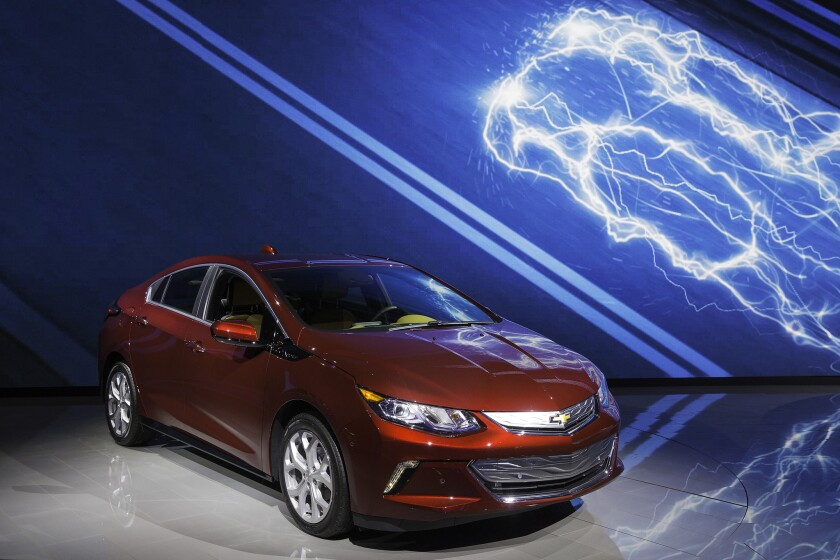 California emissions rules charge debate over all-electric cars vs. hybrids
