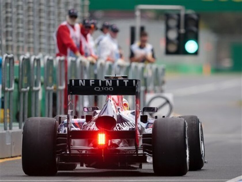 Red Bull driver Sebastian Vettel of Germany steers his car during the first practice session for Sunday's Australian Formula One Grand Prix at Albert Park in Melbourne, Australia, Friday, March Friday, 2013. (AP Photo/John Donegan)