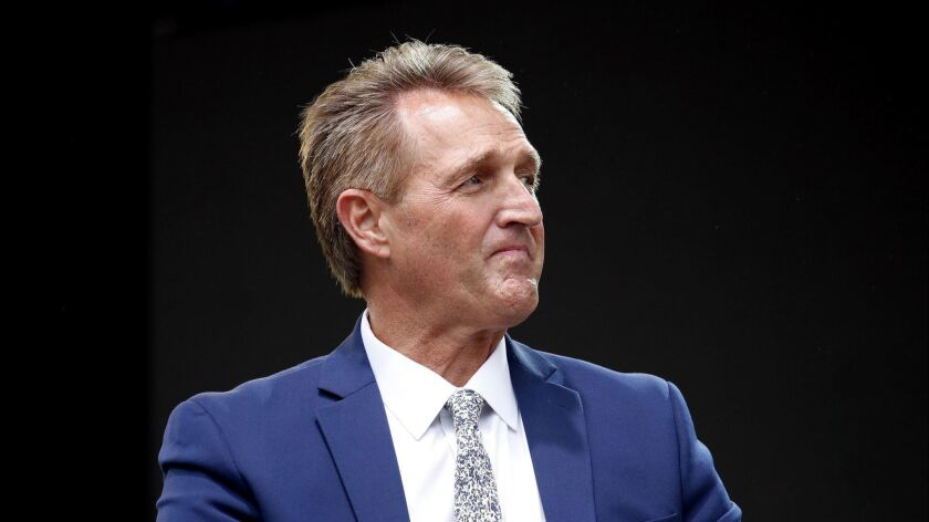 Sen. Jeff Flake, R-Ariz., listens to a question during an appearance at the Forbes 30 Under 30 Summi