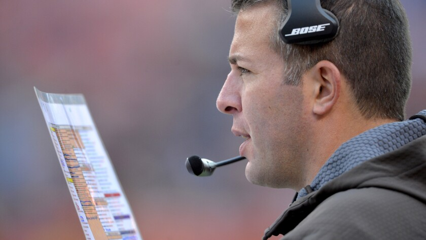 Browns offensive coordinator John DeFilippo checks his color-coded play card during a game against the Bengals on Dec. 6.