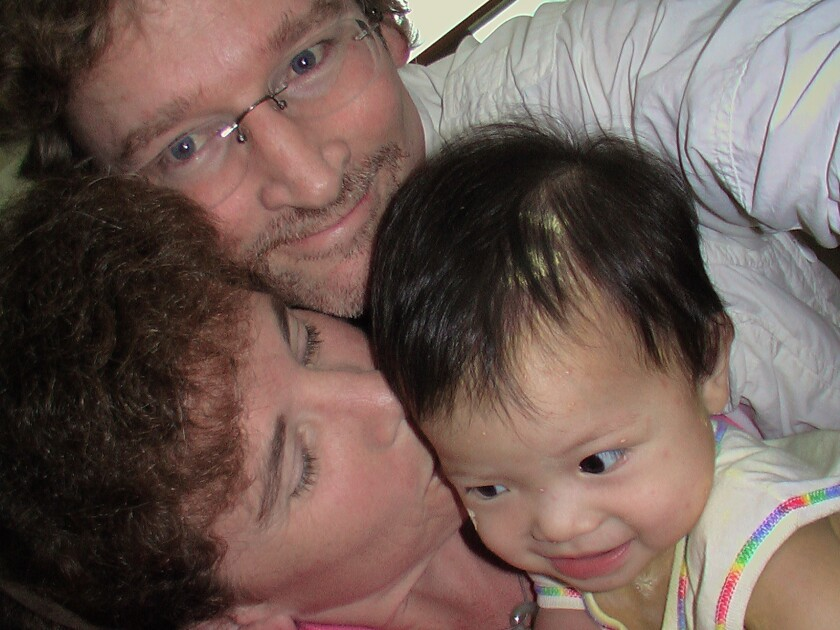 Christopher Reynolds, wife Mary Frances and newly adopted baby Grace, in China in 2005.