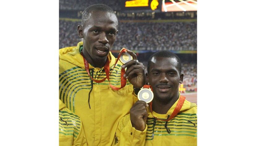 FILE - In this Saturday, Aug. 23, 2008 file photo, Jamaica's men's 4x100 meters relay team members U