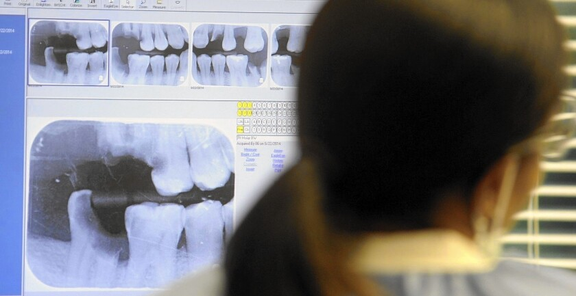 The Supreme Court is considering a case involving dentists in North Carolina who used a state board to block kiosks at shopping malls from offering teeth-whitening products. Above, a dentist's office in Largo, Fla.