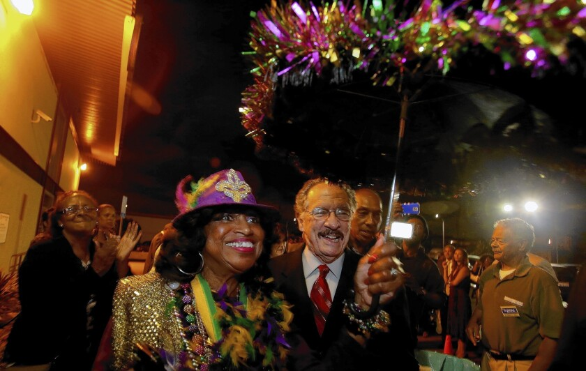 L.A. school board candidate George McKenna makes a New Orleans-style entrance to an election night party in the Crenshaw District.