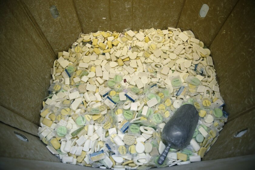 In this March 20, 2015, photo, A box of used bars of soap ready to be ground up are seen at Clean the World in Las Vegas. The non-profit initiative recycles soap from hotels to distribute in developing countries. (AP Photo/John Locher)