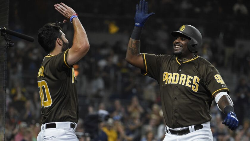 Franmil Reyes, right, is congratulated by Eric Hosmer after hitting a solo home run in the fourth inning Friday against the Colorado Rockies.