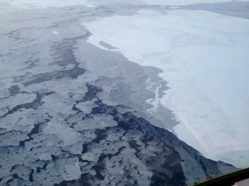 This handout photo provided by The National Oceanic and Atmospheric Administration (NOAA) shows Arctic sea ice in 2013. The Arctic isn't nearly as bright and white as it used to be because of more ice melting in the ocean, and that's turning out to be a global problem, a new study says. With more d