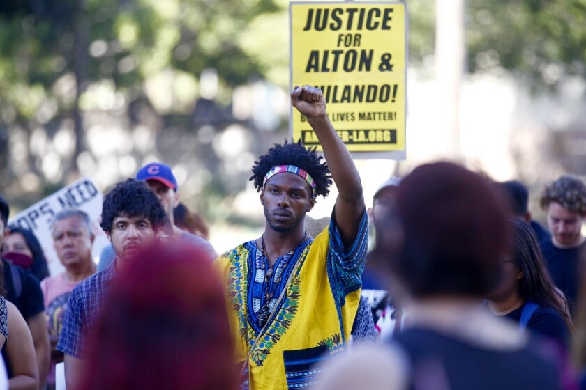 Colton Jones protests outside LAPD headquarters in response to the deaths of Alton Sterling and Philando Castille.