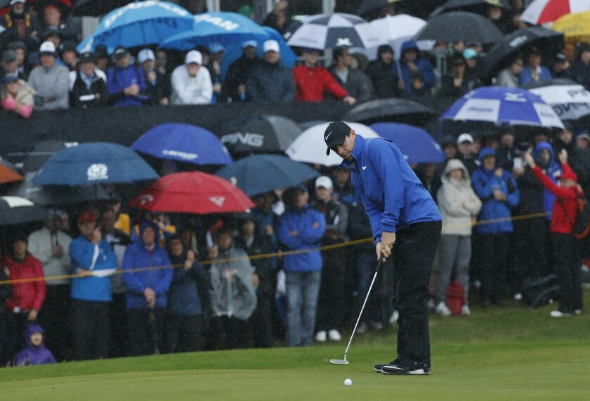 Rory McIlroy of Northern Ireland puts on the 12th green during the second round of the British Open Golf Championship at the Royal Troon Golf Club in Troon, Scotland, Friday, July 15, 2016. (AP Photo/Ben Curtis)