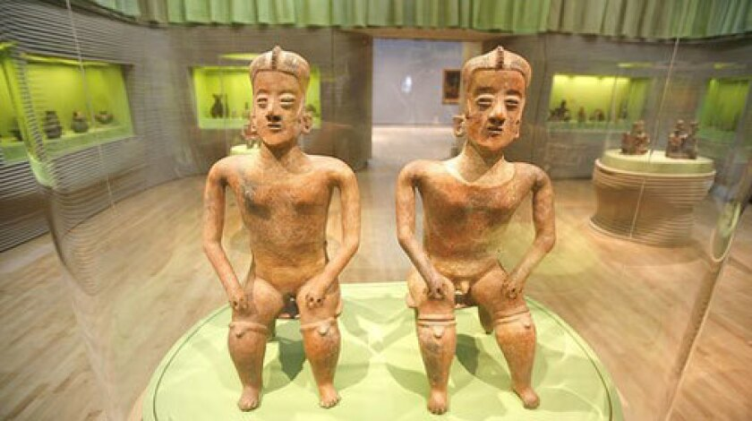 """PRE-COLUMBIAN: """"Male and Female Figures Seated on Benches,"""" Mexican ceramics dating from between 200 BC and AD 500, are on display in one of the new Latin American art galleries at the Los Angeles County Museum of Art."""
