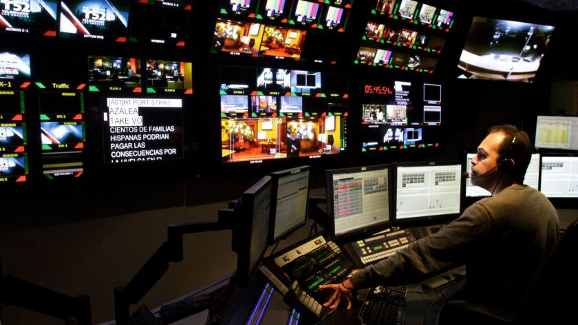 Director Niels Canelo works in the control room at Telemundo's local news station, KVEA-TV Channel 52, in Burbank.